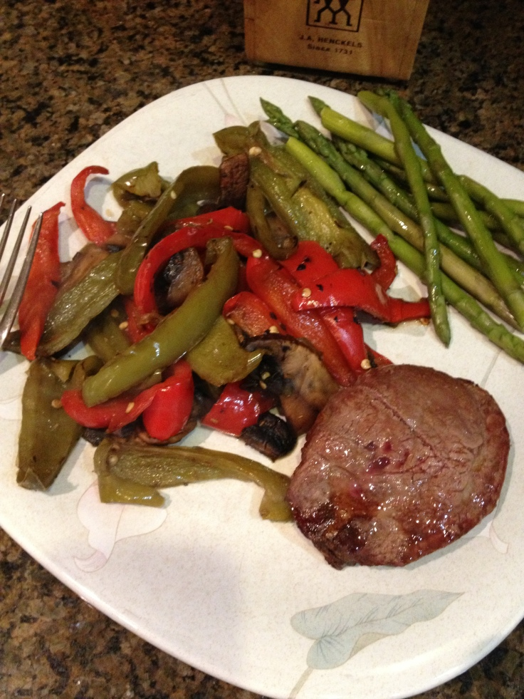 A lean burger, along with peppers and asparagus.