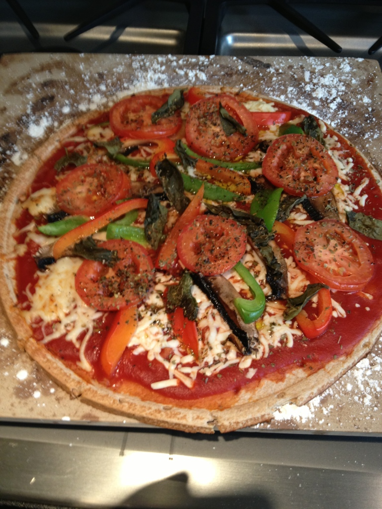 The finished pizza, basil added along with a dash olive oil. Bake at 400 for about 12-15 minutes.