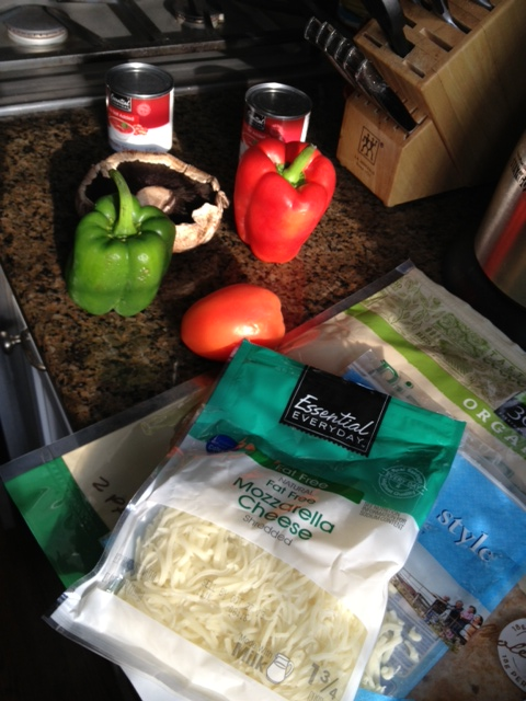 Starting ingredients --- peppers and mushrooms, no-fat cheese and a whole wheat low-salt pizza crust.