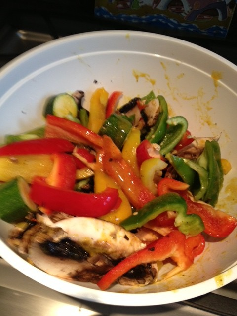 Peppers and mushrooms cut into slices and marinading in a salt-free marinade.