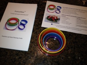 The PortionMate rings and meal planning booklet.