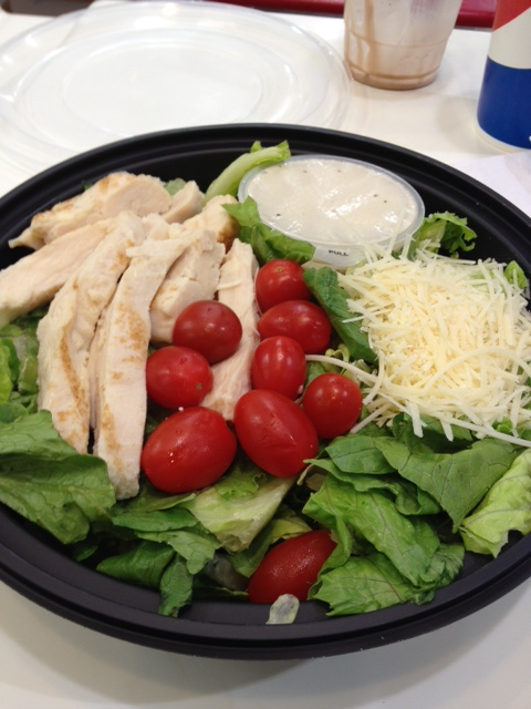 This is what a Costco food court Caesar salad looks like when you unwrap it, a giant cup of fat-filled Caesar dressing and a mound of high-salt, high-fat grated cheese