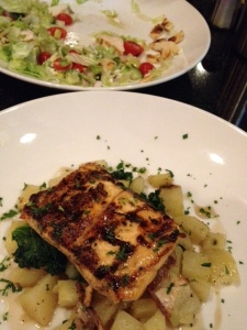 Salmon over potatoes and kale at 27Live