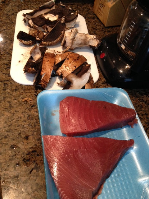 A little over a pound of ahi tuna cut into two pieces for cooking. Accompanied by portobello mushrooms, a great combination.