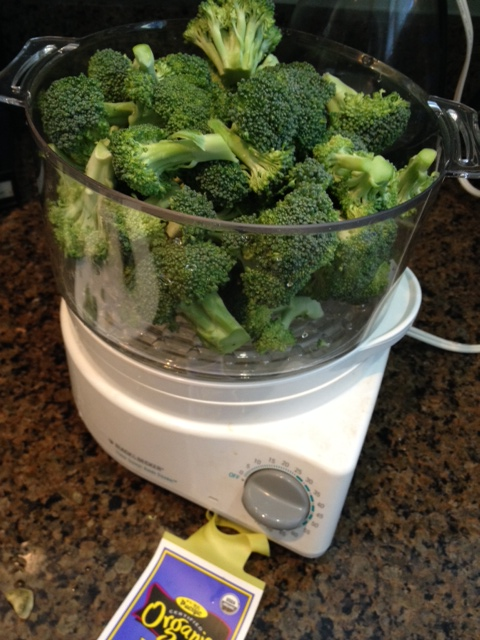 Put the trimmed broccoli in the steamer basket, cover and set the timer to the recommended cooking time.