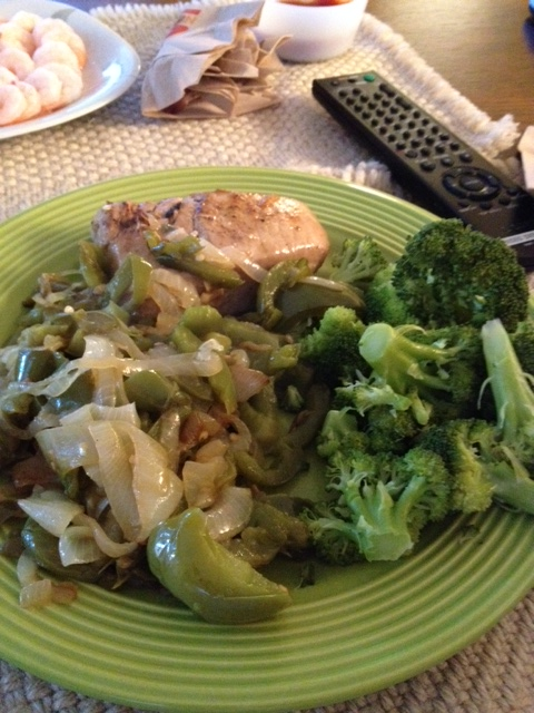 Marinated ahi tuna with peppers and onions and broccoli.