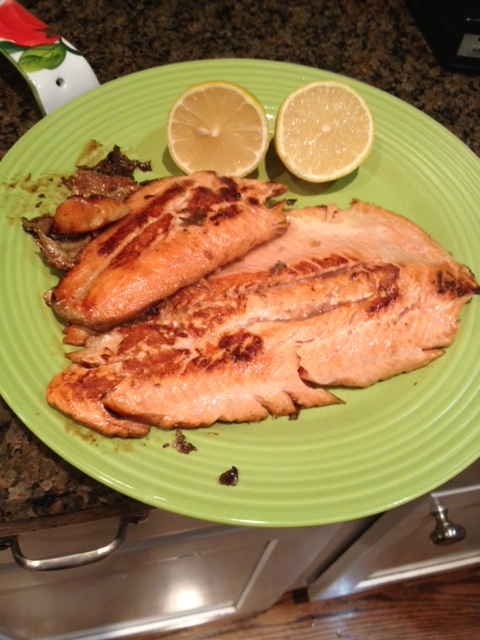 Steelhead trout served simply with lemon on the side.