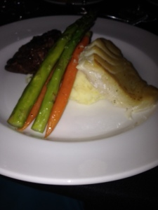 My New Year's Eve meal of steak, bass and veggies over potatoes.