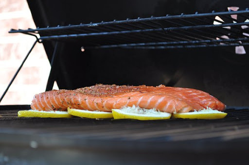 A tasty idea, grill fish on a bed of lemon slices.