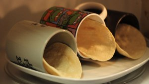 Here's an easy way to turn soft tortillas into hard taco shells.