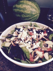 A July 4th salad with romaine lettuce, tomatoes, low-salt olives, fat-free feta, mushrooms and salmon.
