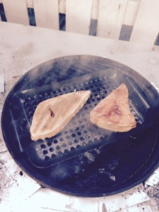 Grilling our swordfish steaks.