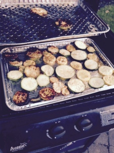 Zucchini on the gas grill, basted with olive oil and Italian spices.