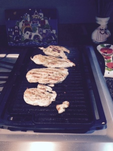 Grilling chicken breasts on my new grill pan.