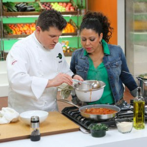 Recipe Rehab's Chef Richard and show host Evette Rios watching him make this tomato sauce.