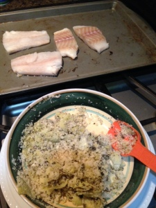 Mixing coating ingredients for the cod with the fillets in the background.